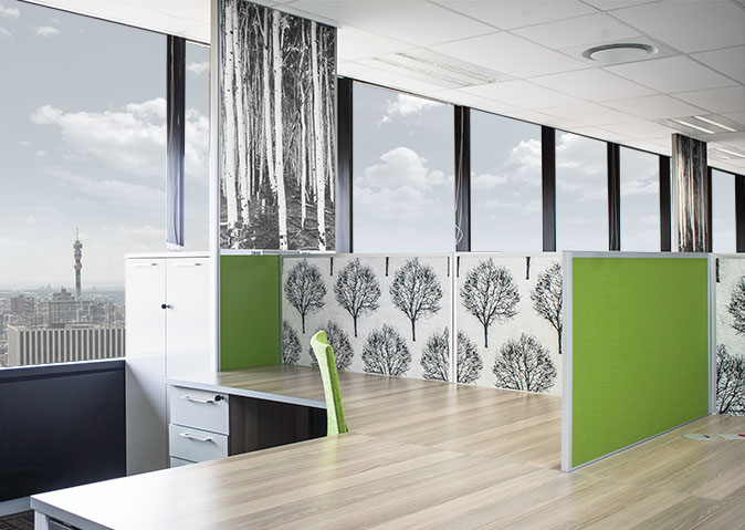 Green office cubicles and desk