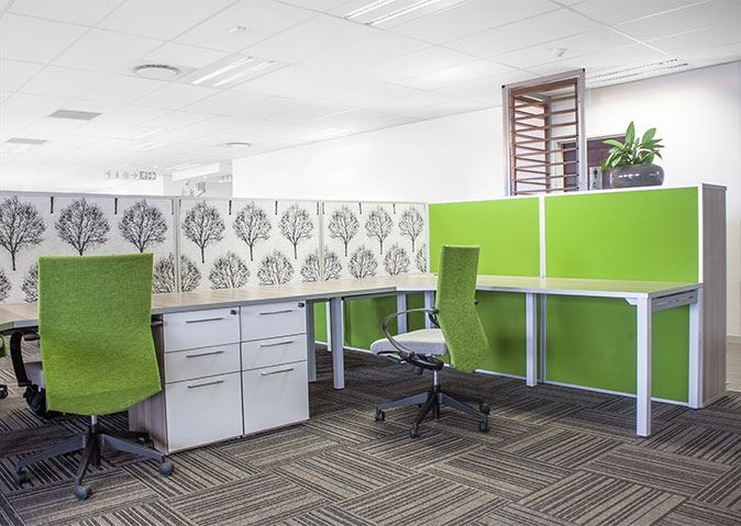 Green office chairs and workstations
