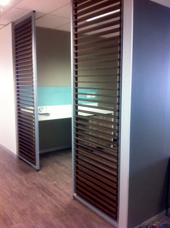 Brown slatted screen partitioning