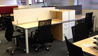 Open plan cluster desks with mesh back chairs