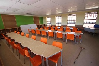 School Desks and Plastic Chairs Image
