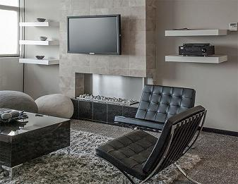 Black leather couches accompanied by a server table