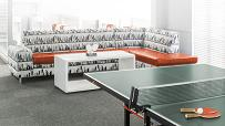 White and black fabric couches in the entertainment area