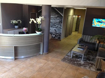 Reception counter with couches and wall art