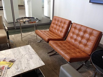 Brown leather chrome couches and coffee table