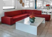 Red couches with white server table