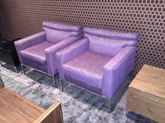 Single fabric sofas and glass coffee table
