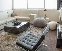 White soft chairs black leather couches