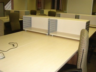 Clustered desks with overdesk Storage Units for Lever Arch Files Image