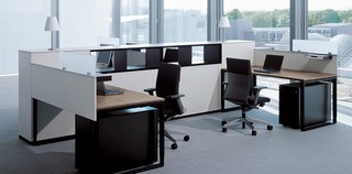 Desks with Steel Open Square supports and Mobile pedestals.. Image