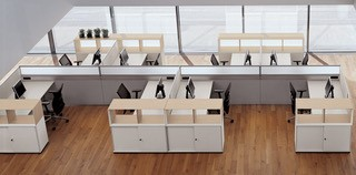 Desks with curved corners including mobile storage... Image