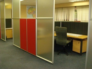 Glass and Fabric combination of Demountable Floor to Ceiling Screens providing privacy Image