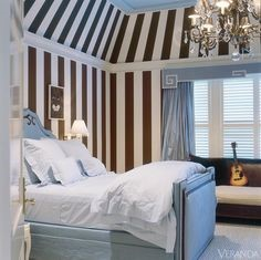 Fabric Wallpaper stripe clad onto bedroom walls Image
