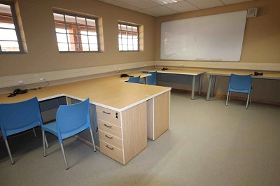 School cluster desks and plastic chairs