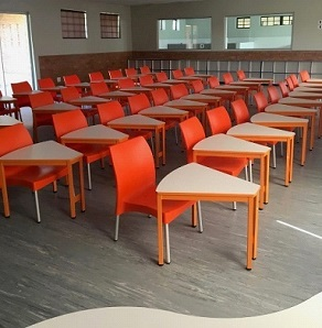 Orange smart school desks with orange chairs