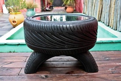 Outdoor tyre coffee table with glass top