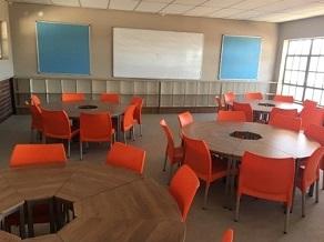 Round smart school desks with orange chairs