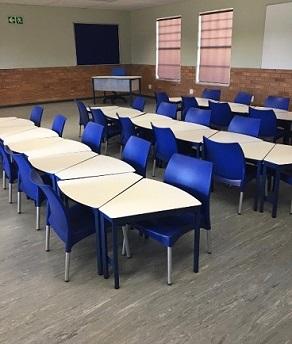 Smart school desks with blue chairs