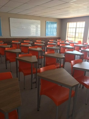 Smart school desks with orange chairs