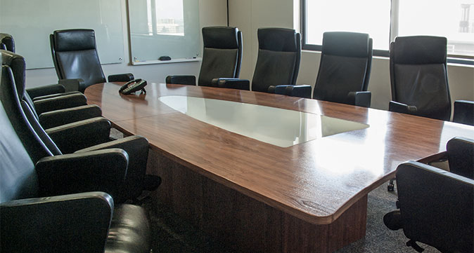 Boardroom with black leather chairs