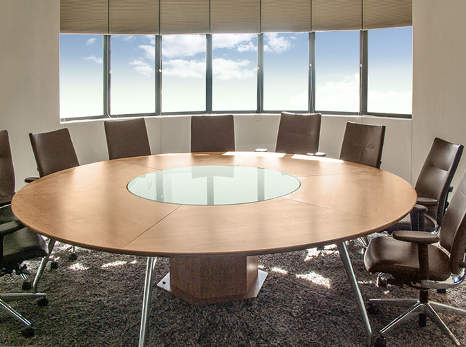 Round table designed to fit in circular shaped boardroom