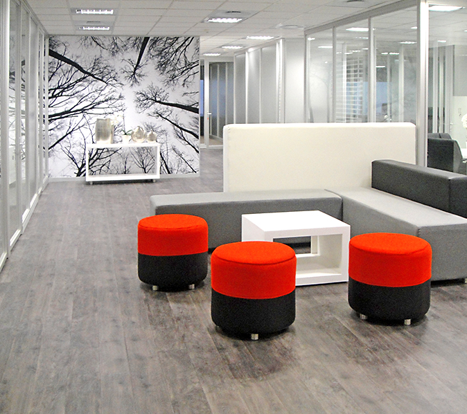 Reception waiting area with round soft chairs in black and red fabric