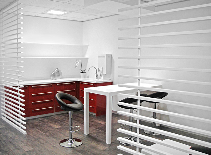Office kitchen with chrome and leather chairs